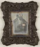 Visualizza Portrait of a bearded man, wearing a coat, se… anteprime su