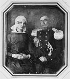 Visualizza portrait of a seated couple, the man in unifo… anteprime su