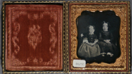 Visualizza Full length portrait of two seated young girl… anteprime su