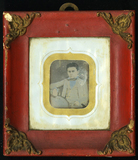 Miniaturansicht Vorschau von Half length frontal portrait of seated boy ho…