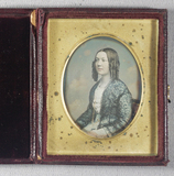 Thumbnail preview of Half length seat portrait of a woman facing t…