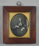 Visualizza Head and shoulders portrait of a seated woman… anteprime su