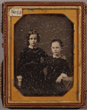 Visualizza Portrait of  two young girls, sisters in thre… anteprime su