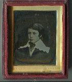 Visualizza Portrait of boy wearing a dark jacket topped … anteprime su