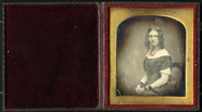 Visualizza Half length portrait of seated young lady wea… anteprime su
