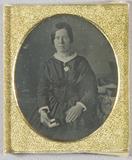 Visualizza Half-length portrait of a woman in a  dark dr… anteprime su