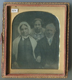 Thumbnail preview of Family portrait. Father and mother are seated…