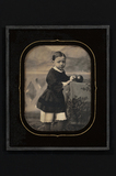 Thumbnail preview of Portrait of a child, standing on a table with…