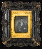 Visualizza Portrait of a young man, half figure, seated … anteprime su