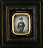 Thumbnail preview of Three-quarter portrait of boy with cap