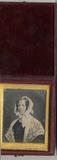 Visualizza Portrait of a woman wearing a lace shawl. She… anteprime su