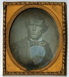 Visualizza Bust portrait of young man facing front anteprime su