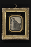 Thumbnail preview of Portrait of girl, standing behind a chair wit…