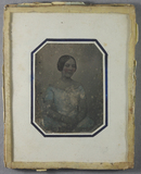 Visualizza A half length portrait of a seated young woma… anteprime su