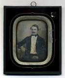 Miniaturansicht Vorschau von Portrait of man with dark glossy hair, handle…