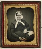 Visualizza Porträt einer alten Frau mit einem Buch in de… anteprime su