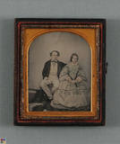 Visualizza Full lenght portrait of seated couple. Tinted… anteprime su