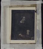 Visualizza Junge Frau seitlich sitzend mit einem Buch in… anteprime su