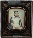 Visualizza Three quarter length portrait of a seated gir… anteprime su