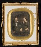 Visualizza Portrait of a couple, half figure, seated, he… anteprime su