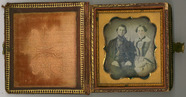 Visualizza Three quarter length portrait of a seated cou… anteprime su