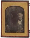 Prévisualisation de A double portrait of a standing and sitting m… imagettes