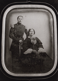 Visualizza portrait of a standing man in uniform and a s… anteprime su