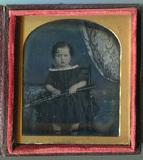 Visualizza Tinted portrait of a child seated near a smal… anteprime su