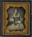 Thumbnail preview of Bildnis einer jungen Frau an einem Tisch sitz…
