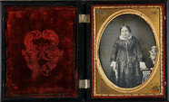 Thumbnail preview of Three-quarter portrait of a woman in a dark d…