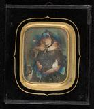 Visualizza Portrait of a woman, half figure, seated, res… anteprime su