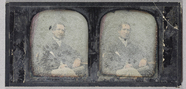 Thumbnail preview of Three quarter length portrait of a seated mid…