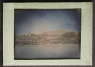 Miniaturansicht Vorschau von View of a town across a river with trees and …