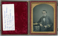 Visualizza Half length portrait of a seated man in a uni… anteprime su