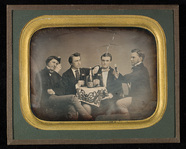 Visualizza Portrait of four young men seated around a ta… anteprime su
