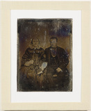 Visualizza Group portrait of a woman and a man sitting. … anteprime su
