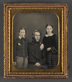 Thumbnail preview of Portrait of seated father with standing son a…