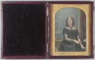 Visualizza Three quarter portrait of a lady standing in … anteprime su