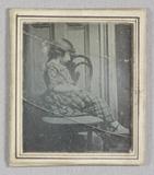 Miniaturansicht Vorschau von Portrait of a child sitting sideways on a cha…