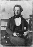 Miniaturansicht Vorschau von portrait of a seated man holding a book