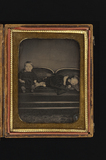 Visualizza Portrait of two children in a long chair, bot… anteprime su