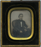 Thumbnail preview of Portrait of a young man, sitting in a chair