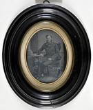 Visualizza Portrait of a sitting gentleman wearing a tie anteprime su