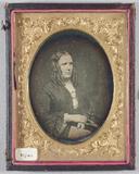 Visualizza Portrait, three quarter length, of a seated w… anteprime su