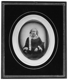 Visualizza portrait of a seated woman with ringlets anteprime su
