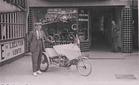 Koksijde: Roger Labyt poseert met een driewieler voor zijn fietsenwinkel