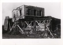 Zandvoorde: stuk geschoten gebouw