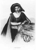 Negentiende-eeuwse Scheveningse vissersvrouw. Ze draagt een mutsje met een gevoerde, rieten vishoed. ...