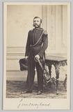 Carte-de-visite van kapitein C.J. van Orsoy Veeren die staat bij een tafel met s…