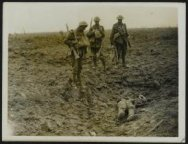 Tommies looking at a dead Boche